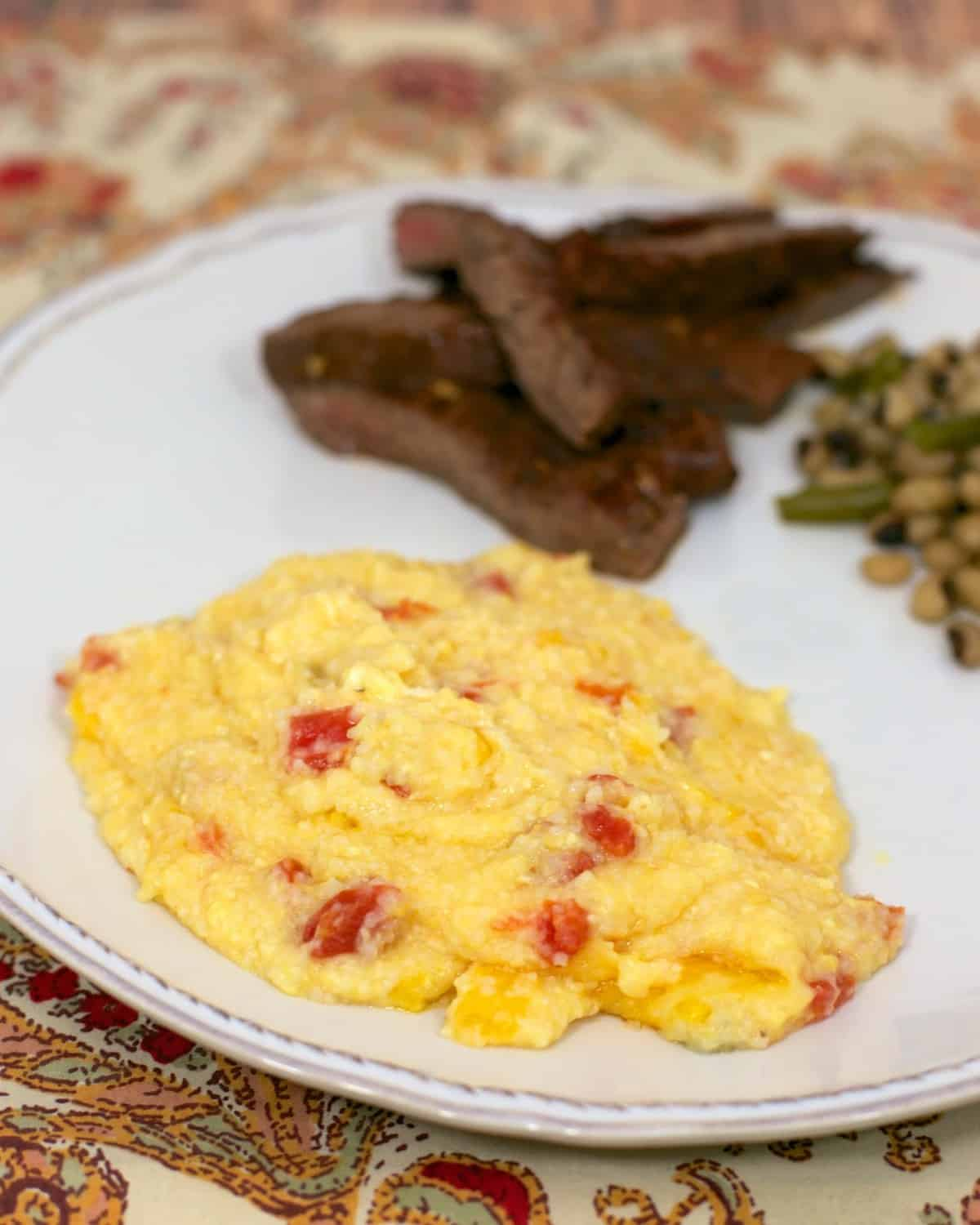 Baked Rotel Cheese Grits - quick side dish recipe - grits, cheese, butter, eggs and rotel - these grits are to-die-for! If you've never tried grits, this is the recipe to make you fall in love with them!