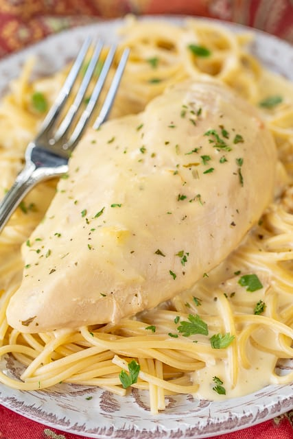 Slow Cooker Ranch Chicken - a weeknight family favorite!! Only 5 ingredients! Chicken, cream cheese, cream of chicken soup, chicken broth and ranch dressing mix. Serve over pasta, grits, rice or potatoes. Everyone cleaned their plate and asked for seconds! That never happens!!! This recipe is a keeper! #slowocoker #chicken #weeknightdinner
