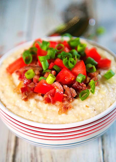 "Slow Cooker Smoked Gouda Grits Recipe - copycat ""City Grits"" from Another Broken Egg restaurant - stone ground grits slow cooked all day. Stir in smoked gouda and top with bacon, tomatoes and green onions. THE BEST grits! I could make a meal out of these yummy grits!"