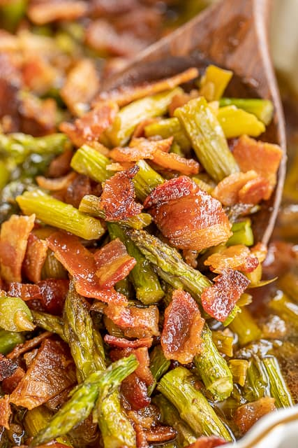 Smothered Asparagus - SO good! Only 6 ingredients!! Fresh asparagus baked in bacon, brown sugar, butter, soy sauce and garlic. This is the most requested asparagus recipe in our house.Everybody gets seconds. SO good!! Great for a potluck and the holidays. Everyone asks for the recipe! Super easy to make. #casserole #asparagus #vegetables #bacon #bakedasparagus