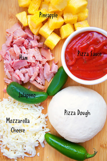 Spicy Hawaiian Pizza - quick homemade pizza that tastes better than any pizza restaurant! Use leftover holiday ham! Everyone loved this flavor combination! Gets a kick from the jalapeños.