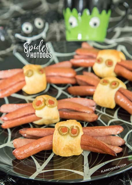 Spider Hotdogs - only 3 ingredients for these festive Halloween hotdogs! Assemble ahead of time and pop in the oven after trick-or-treating. Everyone LOVES these fun spider hotdogs! Perfect halloween party recipe!!
