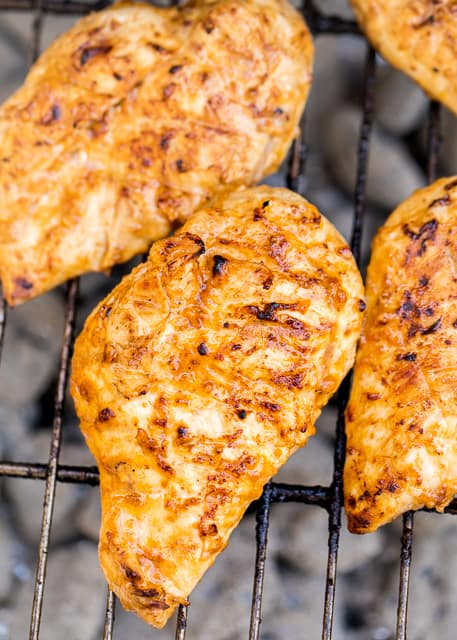 Sriracha Ranch Grilled Chicken Recipe - chicken marinated in olive oil, Ranch dressing, Worcestershire, Sriracha, salt, lemon and vinegar. SOOOO good. We always double the recipe for leftovers.