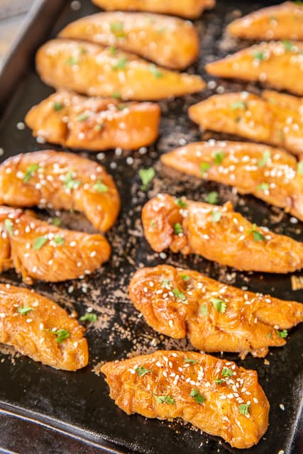 Sticky Chicken - super easy to make and tastes delicious! Chicken marinated in brown sugar, soy sauce, teriyaki sauce, butter, Creole seasoning and dry mustard. Makes a lot - great for meal prep. Serve over rice, noodles, salad or chop up in a wrap. Everyone LOVED this easy chicken recipe! #chicken #chickenrecipe