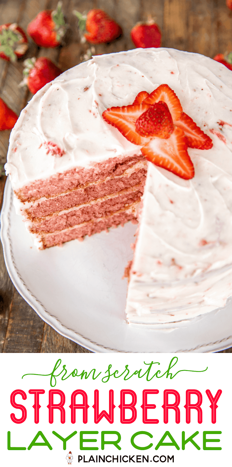 frosted strawberry layer cake on a platter