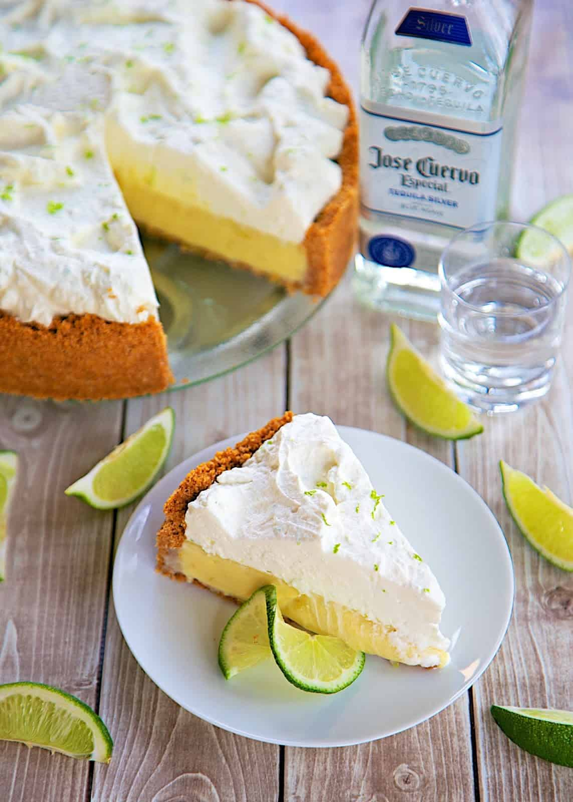 Tequila Key Lime Pie Recipe - cinnamon graham cracker crust, quick key lime pie filling kicked up with a hint of tequila and topped with homemade whipped cream. Perfect for Cinco de Mayo! Delicious Mexican dessert recipe.