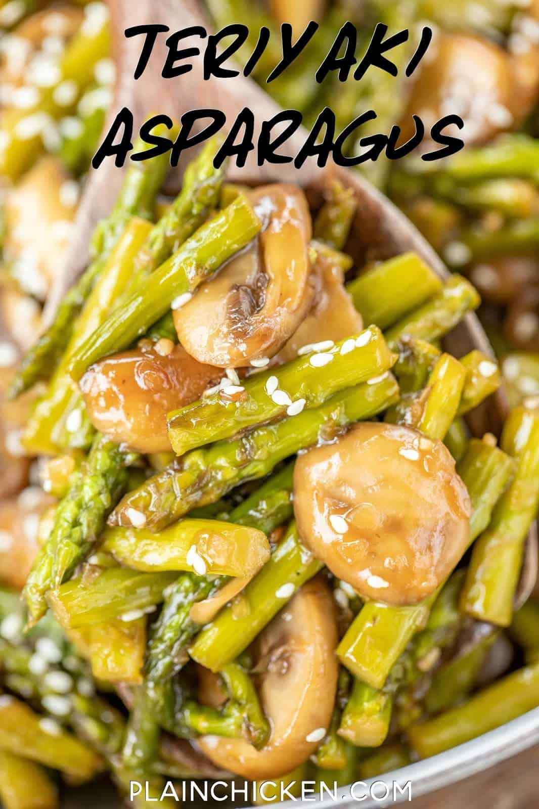 scooping asparagus and mushrooms out of a skillet