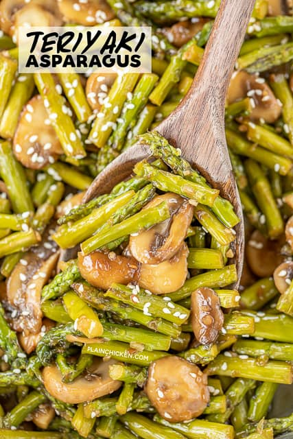 spooning asparagus and mushrooms from skillet