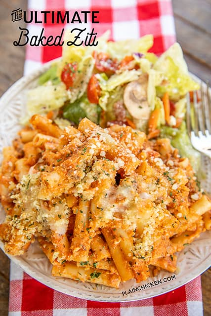 baked ziti on a plate with salad