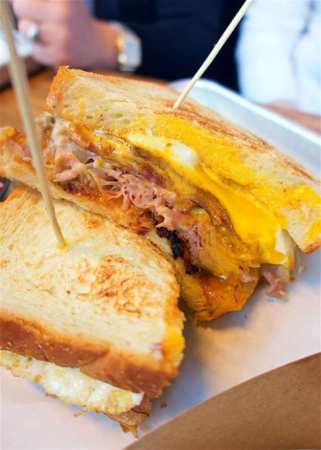 I dream about this Carbonara Sandwich!  Sweet ham, bacon, grilled onions, egg, American cheese and homemade alfredo. Look at it! It was amazing! Tilt in Portland, OR
