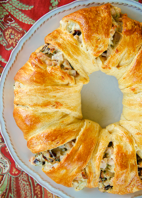 Turkey and Cranberry Wreath - great way to use up leftover turkey. Crescent rolls filled with cooked turkey, mayonnaise, celery, dijon mustard, dried cranberries, swiss cheese and pecans. This is SO good! Can make filling ahead of time and assemble and bake later. Great for parties, brunch, lunch, easy weeknight dinner and tailgating!