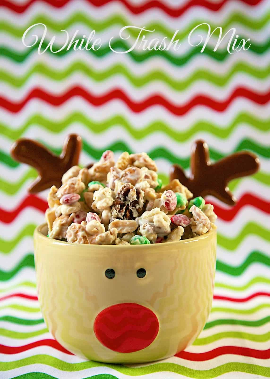 Alton Brown's White Trash Mix - white chocolate chex mix - HIGHLY addictive! Makes great neighbor or co-worker gifts. Chex, mixed nuts, cheerios, m&m candies, pretzels and white chocolate. A must for your holiday dessert tray! Everyone loves this no-bake holiday dessert recipe!