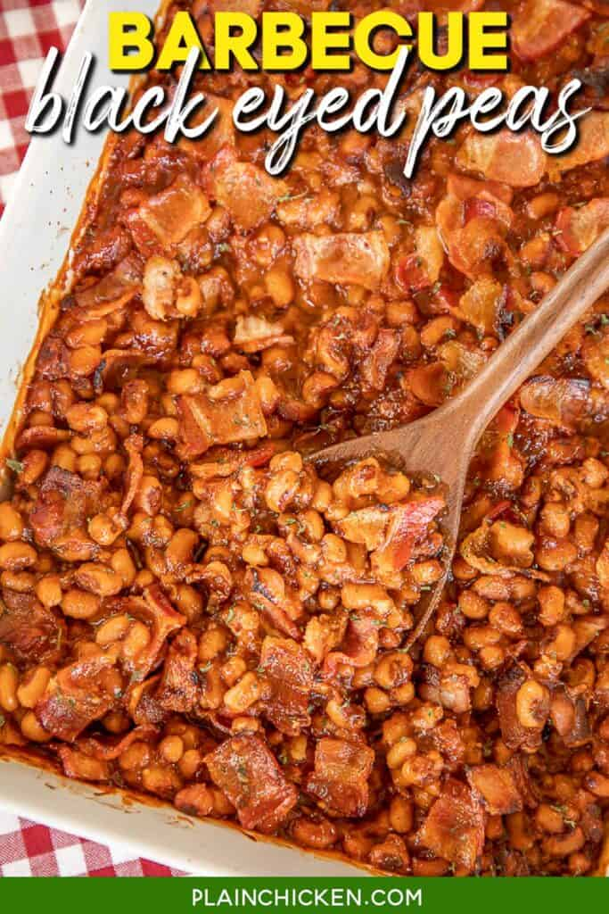 scooping baked beans from baking dish