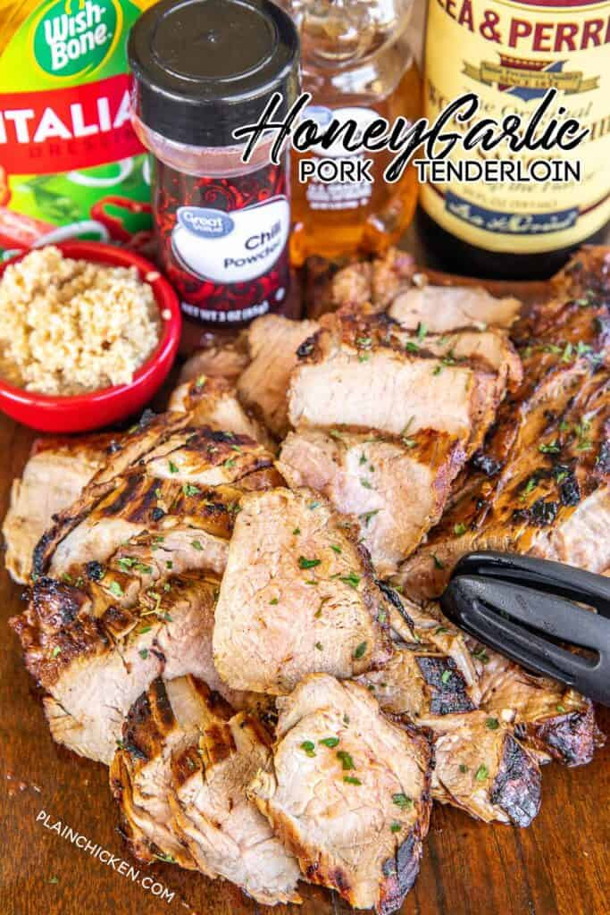 sliced grilled pork tenderloin on a cutting board