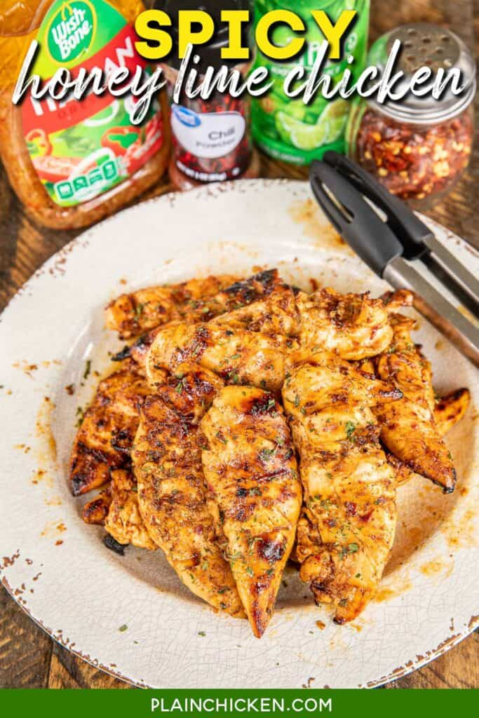 plate of grilled chicken with ingredients behind it