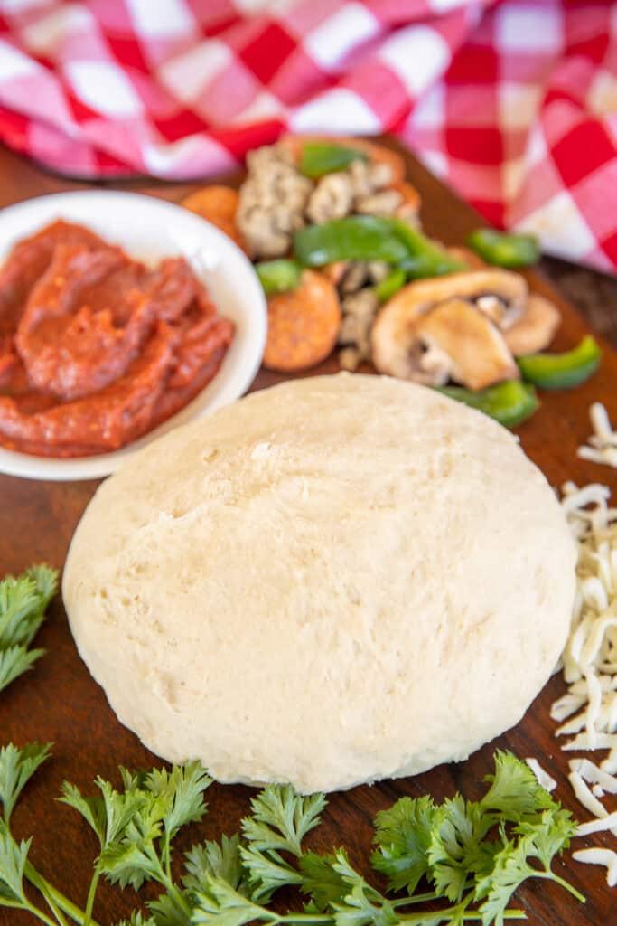ball of pizza dough on a platter