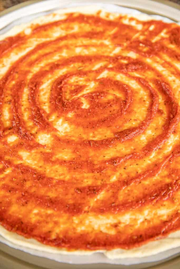 sauce on pizza dough