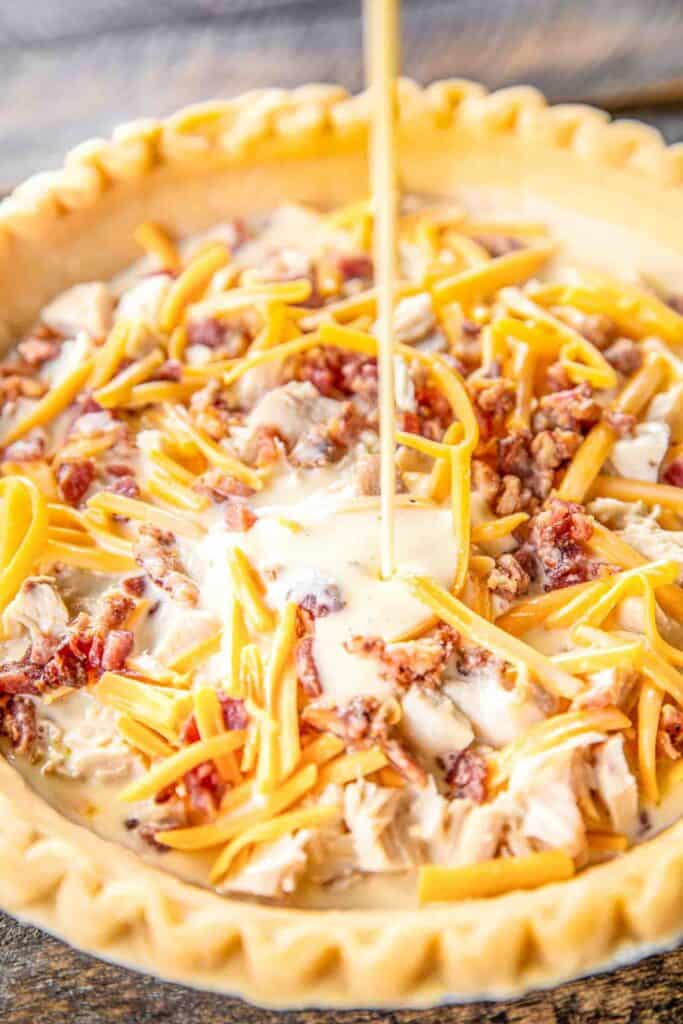 Crack Chicken Quiche - so quick and easy. Everyone LOVED this recipe!! Can make ahead and freeze for later. Pie crust, chicken, cheddar cheese, bacon, ranch dressing, heavy cream, and eggs Ready to eat in an hour. Great for breakfast, lunch or dinner. THE BEST!