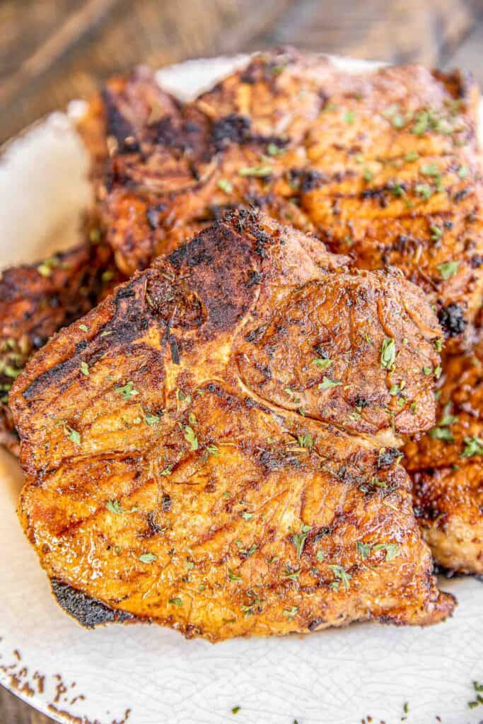 grilled blackened pork chops on a plate