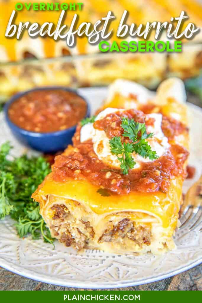 breakfast burritos on a plate with salsa and sour cream