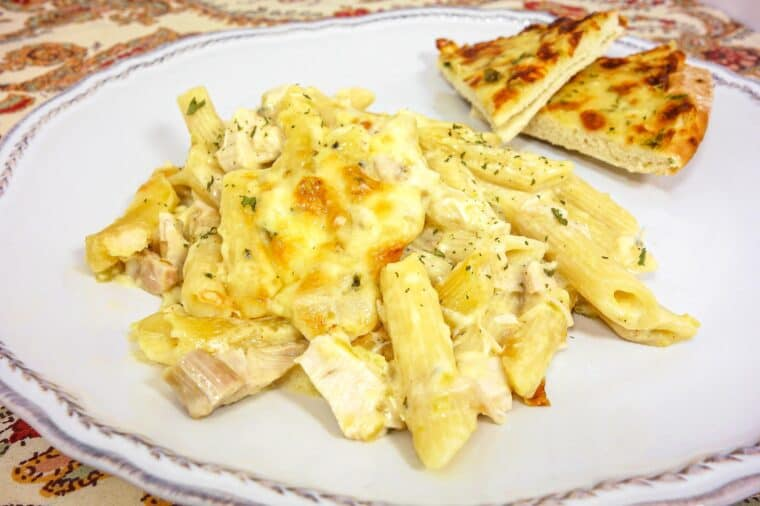 White Chicken Enchilada Pasta -my favorite enchilada recipe with pasta instead of tortillas - much easier! No cream of anything soup!! chicken, pasta, green chiles, cheese, tossed in a homemade sour cream sauce. SO good! I wanted to lick my plate!
