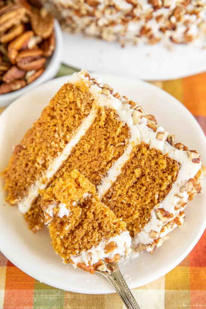 slice of three layer carrot cake