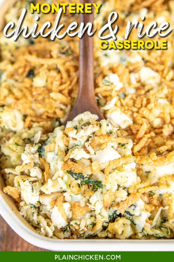 spooning chicken spinach and rice casserole from baking dish