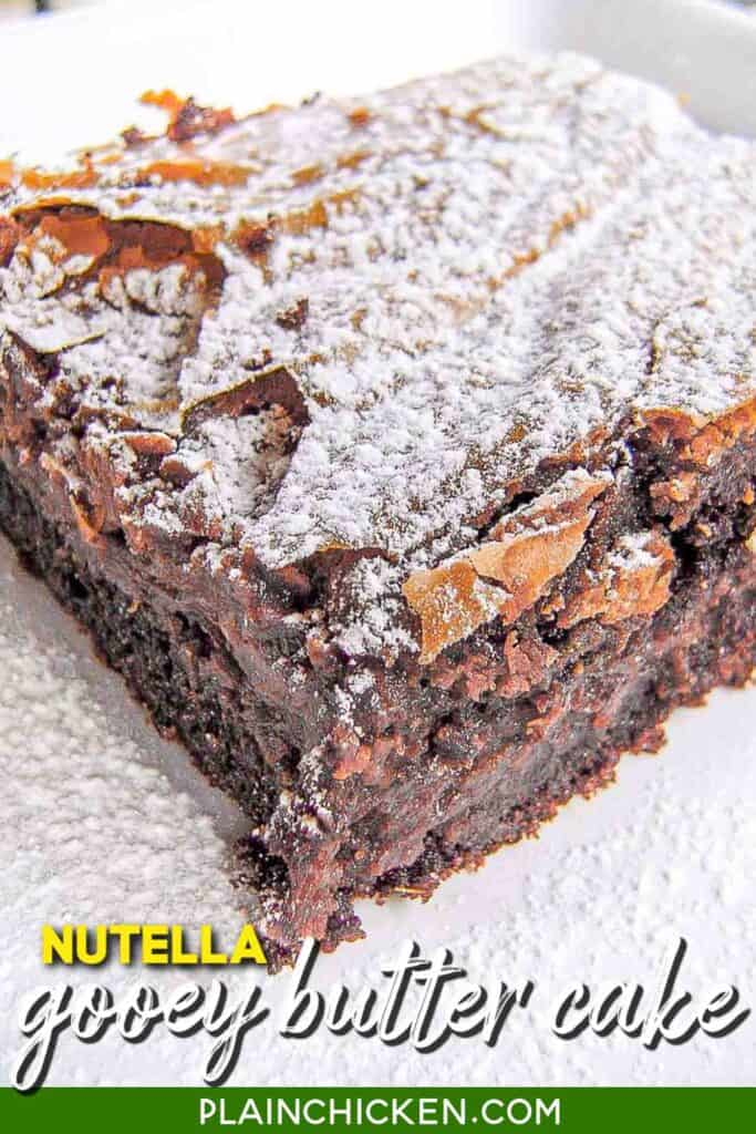 Nutella Gooey Butter Cake - dangerously delicious!! Cake mix, egg, butter topped with cream cheese, nutella, eggs, vanilla, butter and powdered sugar. Serve with whipped cream. This is ALWAYS the first dessert to go!! #nutella #cake #dessert