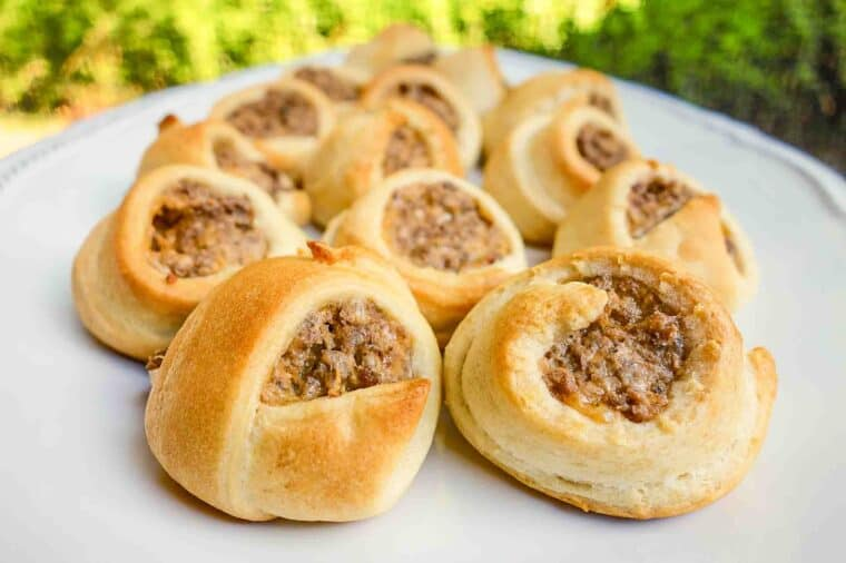 Taco Crescents - taco meat, cream cheese and cheddar wrapped in crescent rolls. Great for a quick dinner or party!! serve with a salsa ranch dipping sauce.