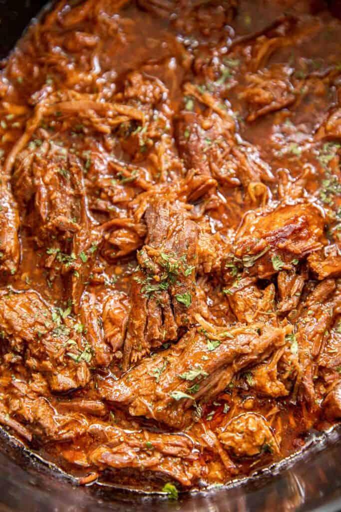 slow cooker of shredded pot roast