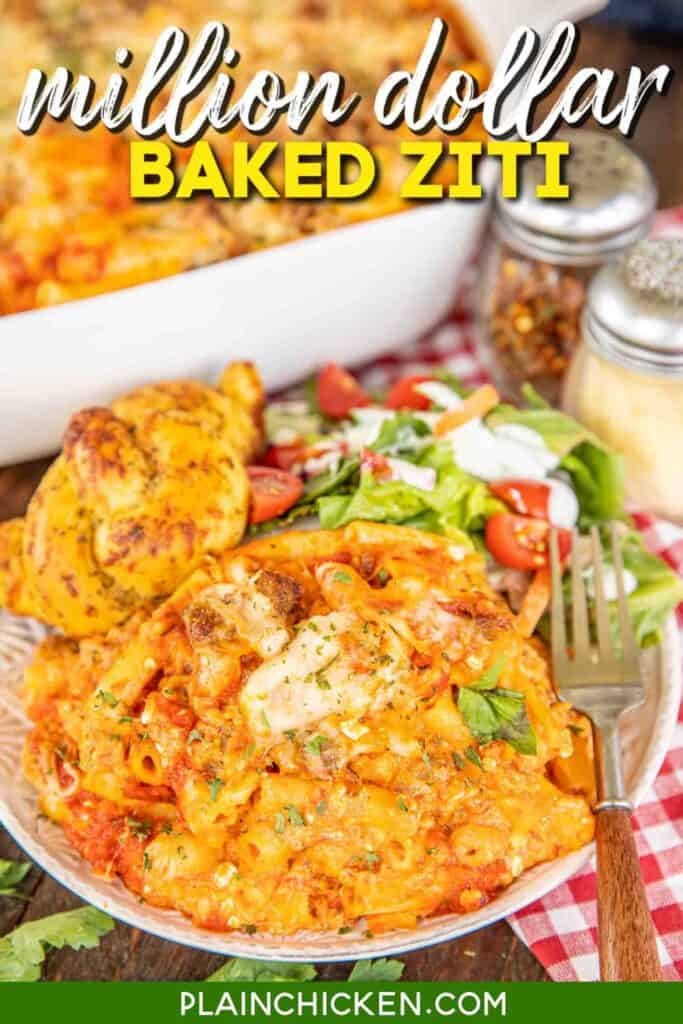 plate of baked ziti with salad and rolls
