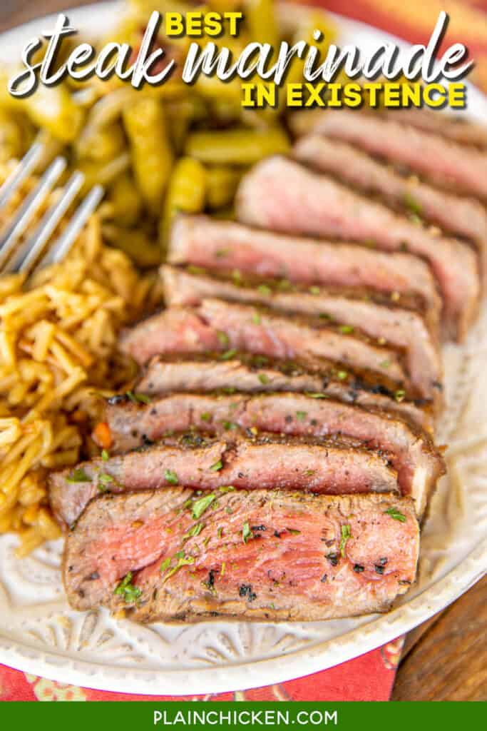 sliced steak on a plate with rice and green beans