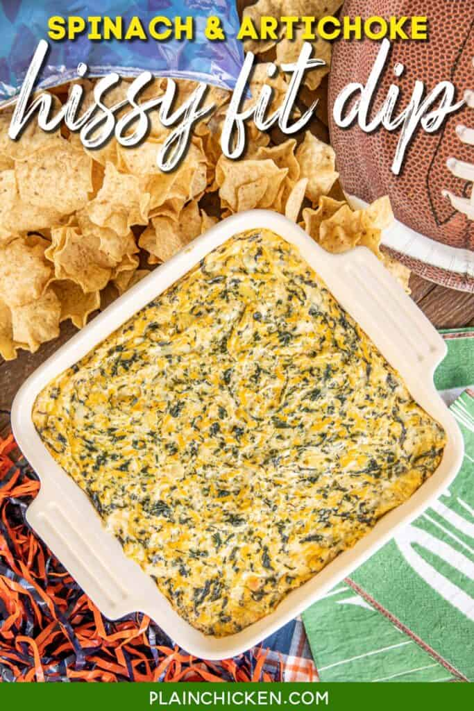 baking dish of spinach dip with chips on the table