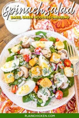 plate of spinach salad and dressing