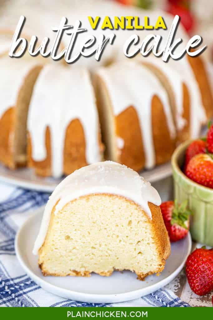 slice of iced pound cake on a plate with strawberries