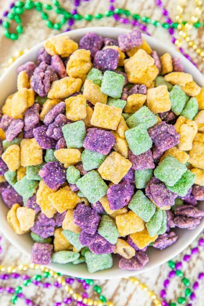 bowl of yellow, purple, and green muddy buddy treats