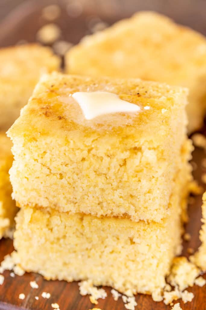 two slices of cornbread stacked on top of each other with butter
