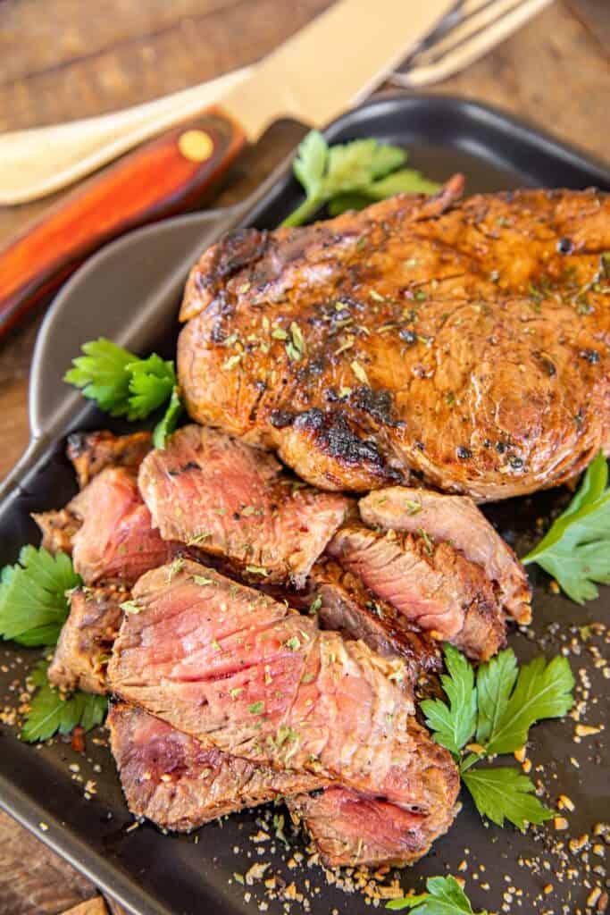 sliced steak on a platter