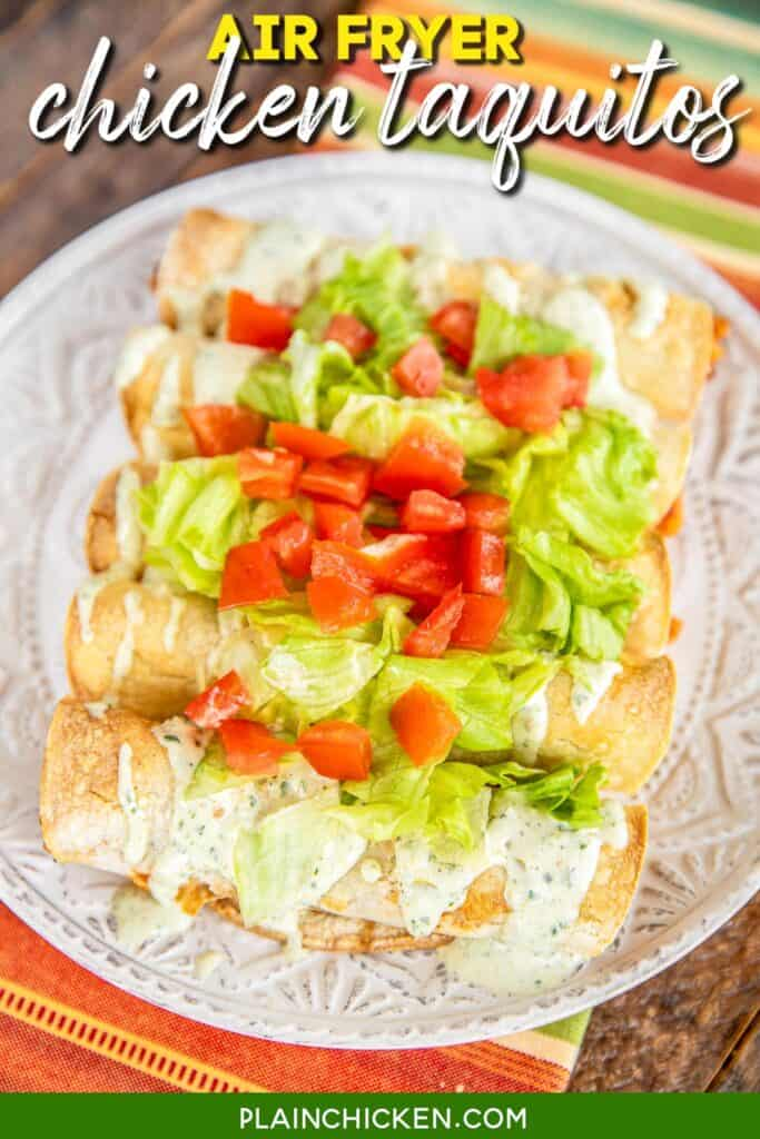 plate of chicken taquitos with lettuce and tomato