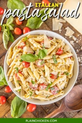 bowl of pasta salad with tomatoes parmesan and basil