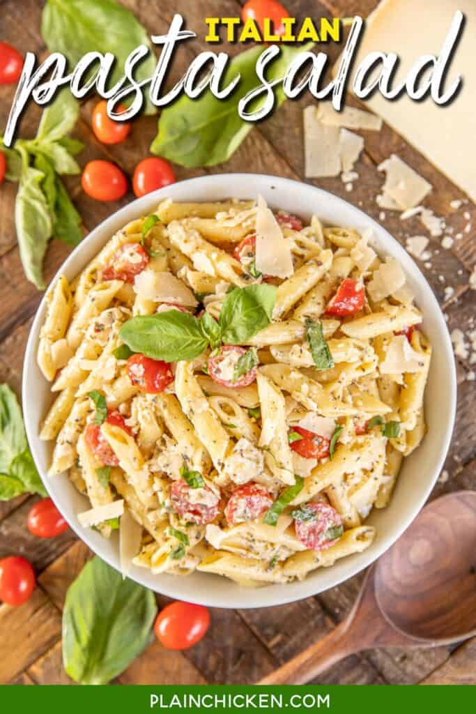 bowl of pasta salad with tomatoes parmesan and basil