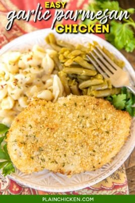 piece of garlic parmesan baked chicken on a plate with green beans and pasta