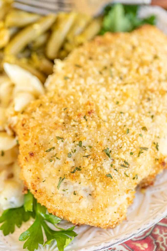 piece of garlic parmesan baked chicken on a plate