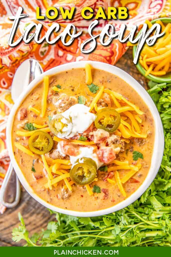 bowl of taco soup topped with sour cream and jalapenos