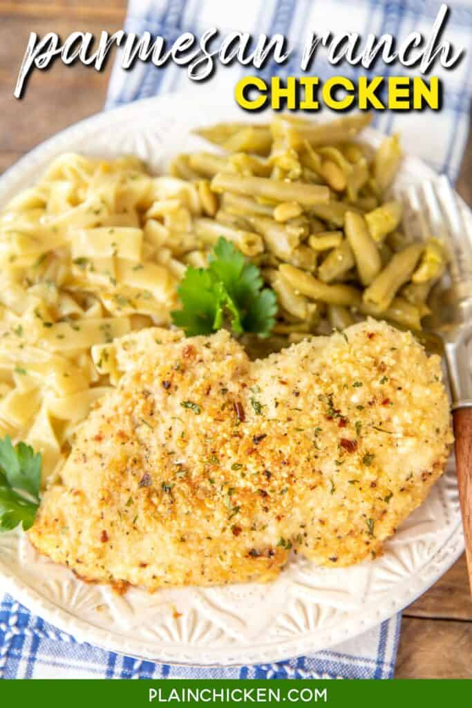parmesan baked chicken on a plate with pasta and green beans
