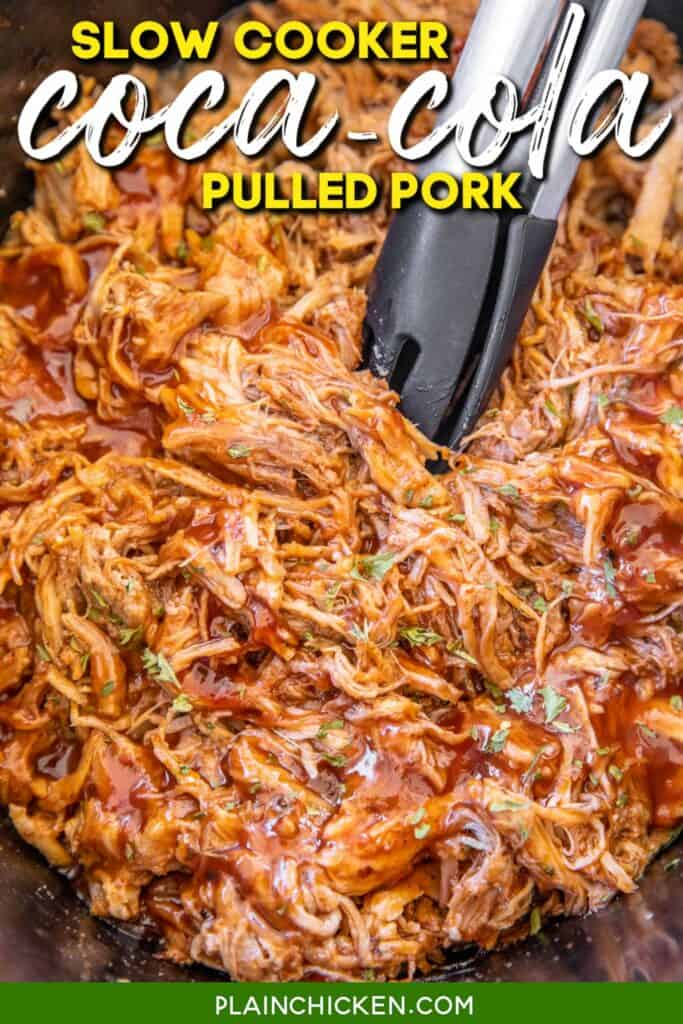 slow cooker of pulled pork with tongs in it