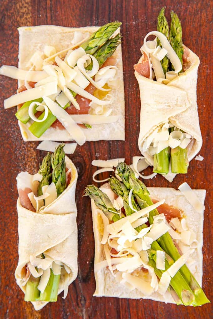 4 puff pastry squares topped with proscuitto asparagus and cheese