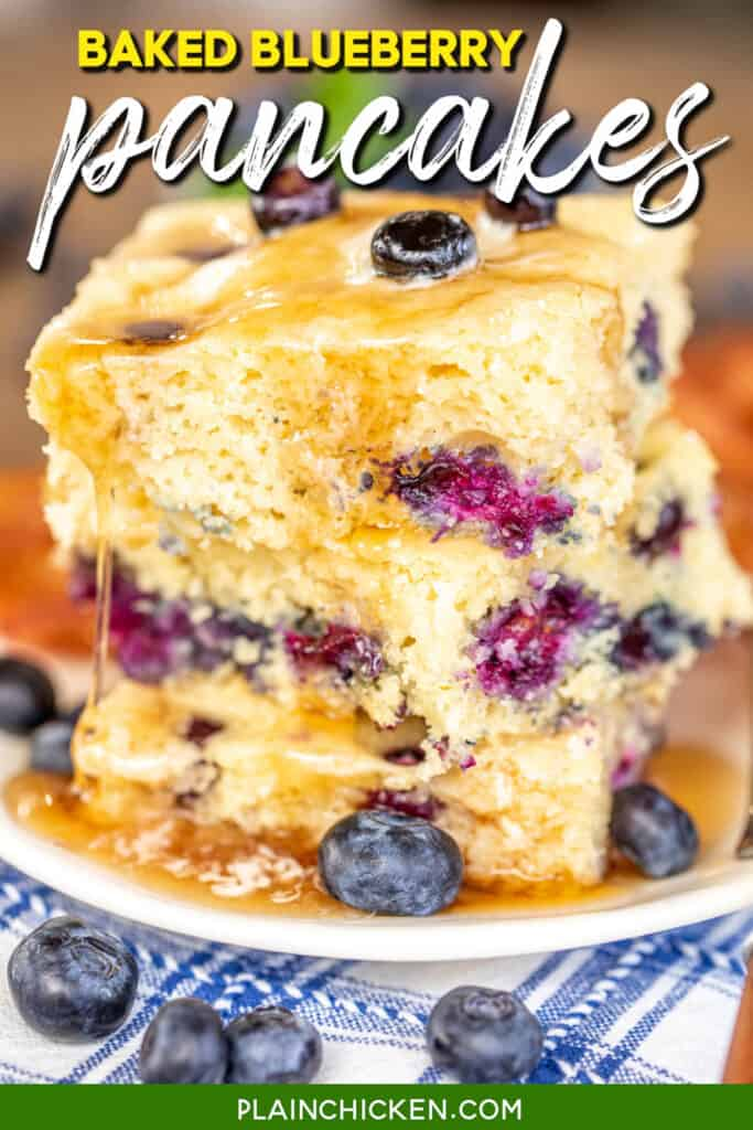 stack of blueberry pancakes dripping with syrup