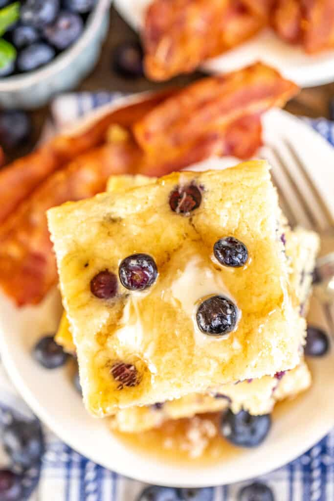 plate of baked blueberry pancakes with bacon
