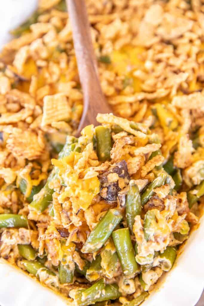 scooping green beans from baking dish